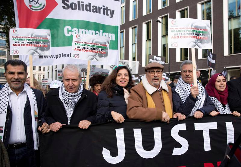 LONDON, UNITED KINGDOM - NOVEMBER 4: (third from right) Ambassador from Palestine to the UK, Manuel Hassassian, joins a national march through central London, England, on November 4, 2017 as they demand justice and equal rights for Palestinians coinciding with the centenary of the Balfour Declaration. (Photo by Isabel Infantes/Anadolu Agency/Getty Images)