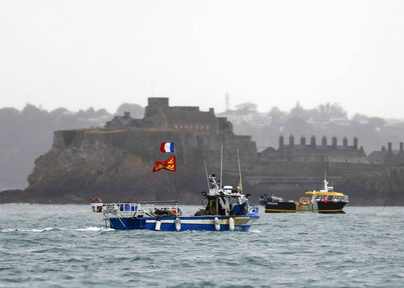 ALTERNATIVE CROP - French fishing boats protest in front of the port of Saint Helier off the British island of Jersey to draw attention to what they see as unfair restrictions on their ability to fish in UK waters after Brexit, on May 6, 2021. - Around 50 French fishing boats gathered to protest at the main port of the UK island of Jersey on May 6, 2021, amid fresh tensions between France and Britain over fishing. The boats massed in front of the port of Saint Helier to draw attention to what they see as unfair restrictions on their ability to fish in UK waters after Brexit, an AFP photographer at the scene said. (Photo by Sameer Al-DOUMY / AFP) / ALTERNATIVE CROP