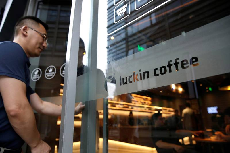 A man walks into a Luckin Coffee store in Beijing, China July 17, 2018. Picture taken July 17, 2018. REUTERS/Jason Lee