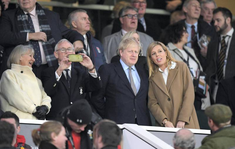 LONDON, ENGLAND - MARCH 07: British Prime Minister Boris Johnson and his partner Carrie Symonds are seen in the stands during the 2020 Guinness Six Nations match between England and Wales at Twickenham Stadium on March 07, 2020 in London, England. (Photo by Shaun Botterill/Getty Images)