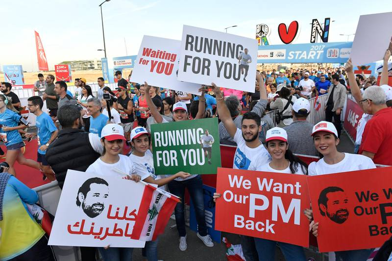 epa06323777 Lebanese youth hold placards demanding the return of Lebanese Prime Minister Saad Hariri from Saudi Arabia during the annual Beirut International Marathon in Beirut, Lebanon, 12 November 2017. Thousands of participants from European and Arab countries took part in the Beirut Marathon under the slogan 'Prime Minister Saad Hariri's return to Lebanon'. Hariri had announced on 04 November 2017 that he resigns from the Prime Minister's office. According to media reports, Hariri said that the current political climate reminds him of the time before the assassination of his father, former Lebanese Prime Minister Rafic Hariri, and he also mentioned Iran's influence in his country, and the region. Hariri came into office for his second term on 18 December 2016.  EPA/WAEL HAMZEH