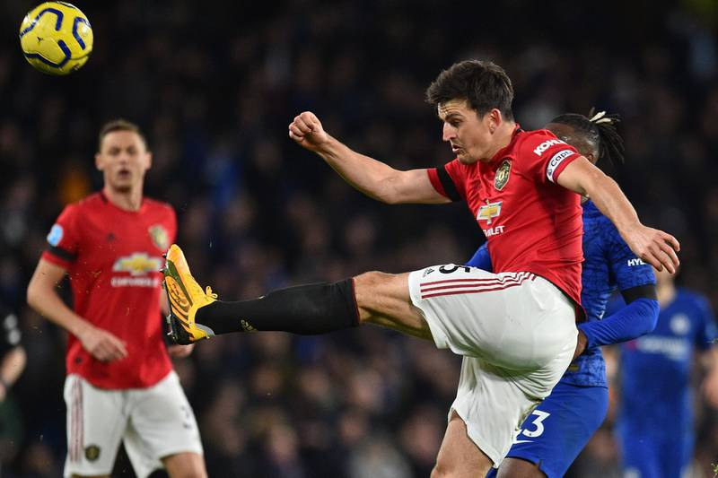 Manchester United's English defender Harry Maguire kicks the ball clear during the English Premier League football match between Chelsea and Manchester United at Stamford Bridge in London on February 17, 2020. RESTRICTED TO EDITORIAL USE. No use with unauthorized audio, video, data, fixture lists, club/league logos or 'live' services. Online in-match use limited to 120 images. An additional 40 images may be used in extra time. No video emulation. Social media in-match use limited to 120 images. An additional 40 images may be used in extra time. No use in betting publications, games or single club/league/player publications.  / AFP / Glyn KIRK                           / RESTRICTED TO EDITORIAL USE. No use with unauthorized audio, video, data, fixture lists, club/league logos or 'live' services. Online in-match use limited to 120 images. An additional 40 images may be used in extra time. No video emulation. Social media in-match use limited to 120 images. An additional 40 images may be used in extra time. No use in betting publications, games or single club/league/player publications.