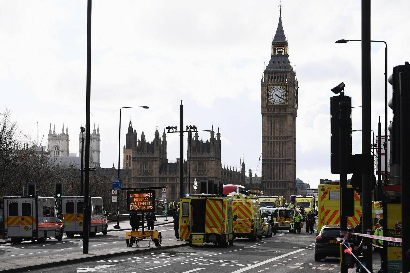 LONDON, ENGLAND - MARCH 22:  Ambulances, police vehicles and emergency services seen on Westminster Bridge on March 22, 2017 in London, England. A police officer was stabbed near to the British Parliament and the alleged assailant shot by armed police. Scotland Yard also reported an incident on Westminster Bridge where one woman has been killed and several people seriously injured by a car.  (Photo by Carl Court/Getty Images)