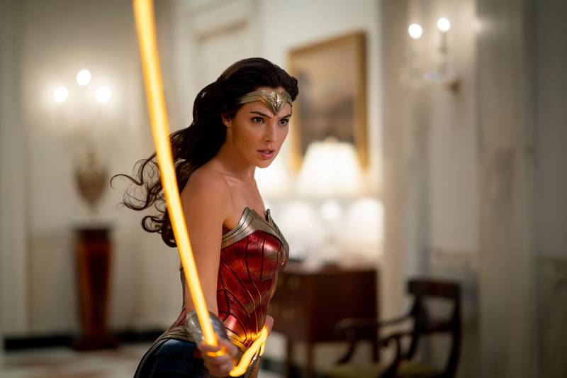 """This image released by Warner Bros. Entertainment shows Gal Gadot in a scene from """"Wonder Woman 1984."""" The superhero sequel earned an estimated $38.5 million in ticket sales from international theaters, Warner Bros. said Sunday, Dec. 20, 2020.   (Clay Enos/Warner Bros. via AP)"""