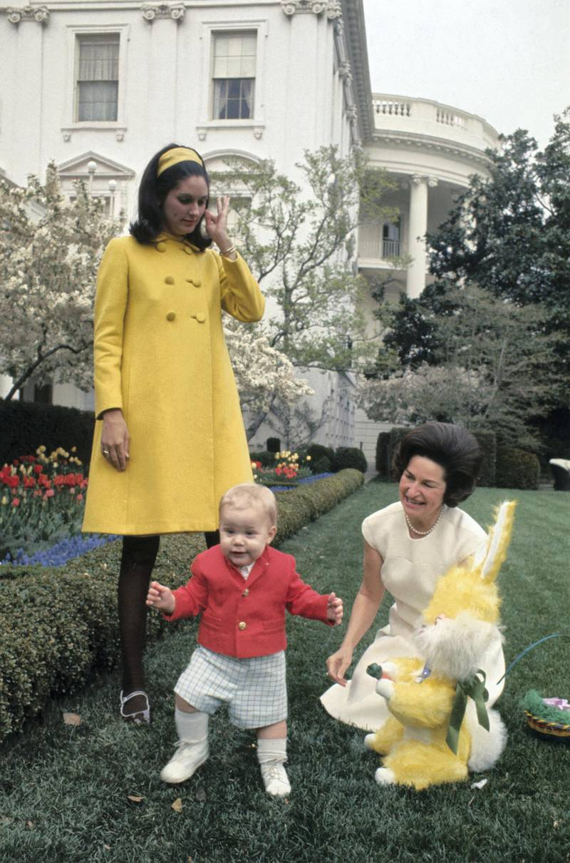 (Original Caption) Lady Bird Johnson is shown in the White House rose garden with her grandson Patrick Lyndon Nugent and an Easter Bunny. Lynda Bird Robb is also shown.
