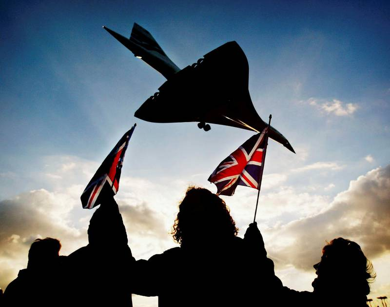 LONDON- OCTOBER 24:  Spectators watch the last ever British Airways commercial Concorde flight touch down at Heathrow airport October 24, 2003 in London. The world's only supersonic passenger aircraft, which has been flying commercial services for 27 years, will be retired by British Airways today. (Photo by Graeme Robertson/Getty Images)
