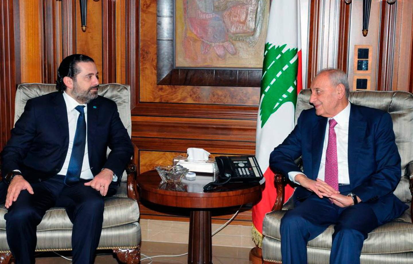 In this photo released by Lebanon's official government photographer Dalati Nohra, Parliament Speaker Nabih Berri, right, meets with outgoing Prime Minister Saad Hariri, in Beirut, Lebanon, Saturday, Dec. 21, 2019. Lebanon's newly designated prime minister says he plans to form a government of experts and independents to deal with the country's crippling economic crisis. Hassan Diab spoke to reporters Friday, following a meeting with former Prime Minister Saad Hariri, a day after he was asked by the president to form the country's next government. (Dalati Nohra via AP)