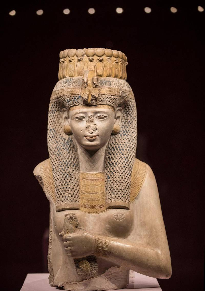 """A picture taken on June 18, 2020 shows a statue of Queen Meritamen, one of the daughters of Rameses II, who became his Great Royal Wife after the death of her mother, Nefertari, at the museum in the Red Sea Egyptian resort of Hurghada. - Egypt will reopen its airports on July 1 and begin welcoming to beach resorts tourists kept away by the coronavirus pandemic, the government announced. Flights will resume """"between Egypt and countries which have reopened their airspace"""", said Aviation Minister Mohamed Manar during a news conference in Cairo. (Photo by Khaled DESOUKI / AFP)"""