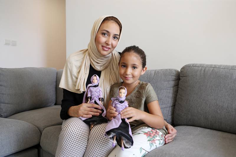 DUBAI , UNITED ARAB EMIRATES , JULY 19  – 2017 :- Left to Right -  Samira Amarir and her daughter Jenna ( 7 years old ) with the Jenna the Quran teacher doll designed by Samira Amarir at her home in Jumeirah Beach Residence in Dubai. ( Pawan Singh / The National ) Story by Anna Zacharia