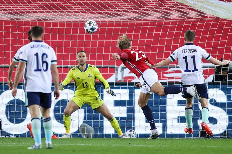 Norway's forward Erling Braut Haaland heads the ball towards Northern Ireland's goalkeeper Trevor Carson's goal during the UEFA Nations League football match Norway v Northern Ireland in Oslo, Norway, on October 14, 2020. (Photo by Orn E. BORGEN / NTB / AFP)