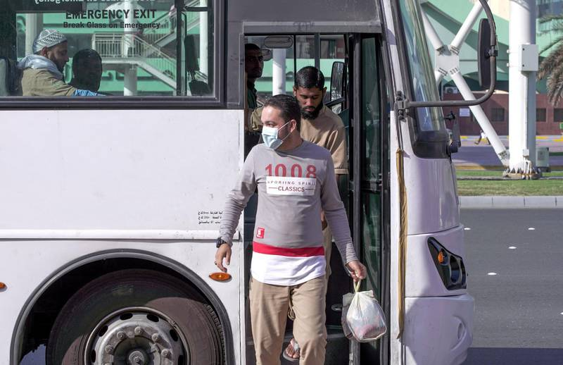 Abu Dhabi, United Arab Emirates, March 5, 2020.  A worker with a face mask disembarks from a bus at the Abu Dhabi Main Bus Terminal area.   FOR:  standaloneVictor Besa / The NationalSection:  NA