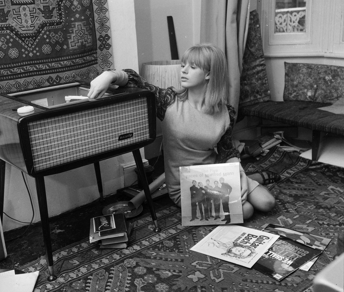 FILE - 4 APRIL 2020: Singer Marianne Faithfull, 74, has been hospitalised with COVID-19 in London 15th October 1964:  Marianne Faithfull playing records at her home in Reading. Among the records scattered on the floor are albums by Pete Seeger and Manfred Mann.  (Photo by John Pratt/Keystone Features/Getty Images)