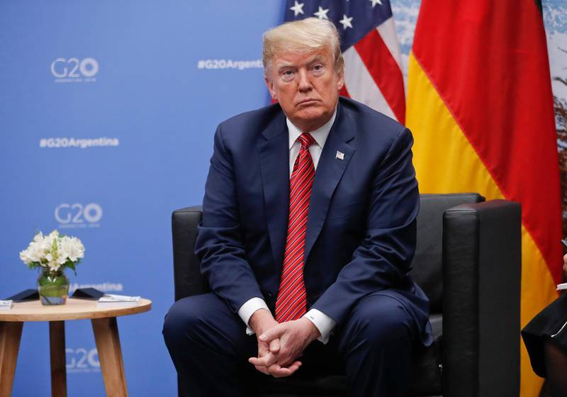 President Donald Trump listens to questions from members of the media during his meeting with Germany's Chancellor Angela Merkel at the G20 Summit, Saturday, Dec. 1, 2018 in Buenos Aires, Argentina. (AP Photo/Pablo Martinez Monsivais)