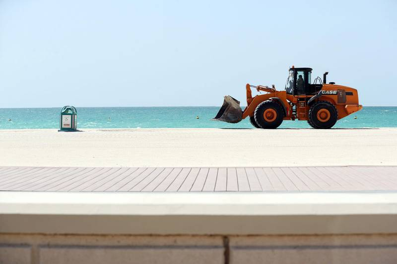 Dubai, United Arab Emirates - Reporter: N/A: Corona. A digger does some work on an empty Jumeirah beach, this is normally a very popular spot for beach goers. Tuesday, April 14th, 2020. Dubai. Chris Whiteoak / The National