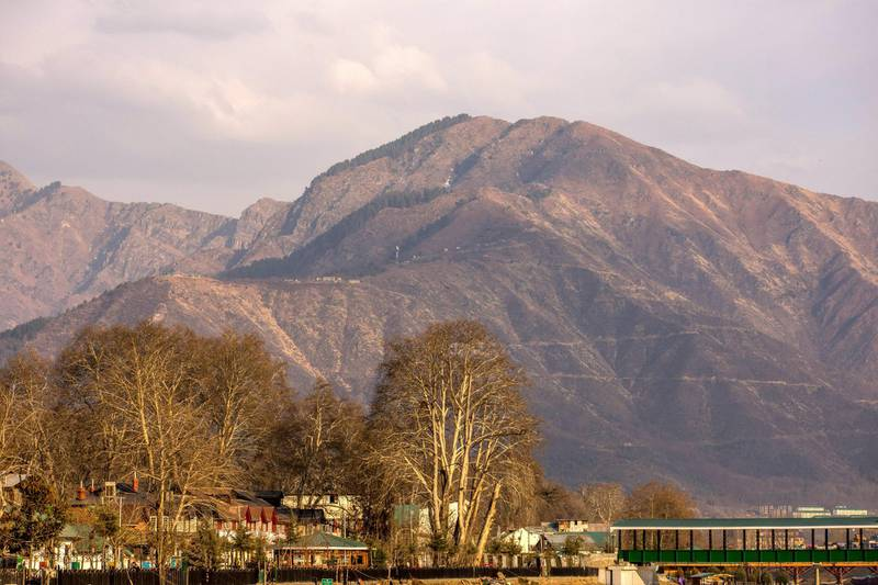 SRINAGAR, KASHMIR, INDIA - FEBRUARY 7: A view of mountains which used to be snow covered, during a warm winter day on February 7, 2018 in Srinagar, the summer capital of Indian administered Kashmir, India.The harshest 40-day period (Chilay Kalan) of the winter is almost over in Kashmir but the valley is yet to receive the season's first snowfall. Winter temperatures have increased in Kashmir and there is less snow now. Biologists believe that climate change is affecting living things worldwide, and the latest evidence suggests that warmer winters and long dry spells have decreased the water flow in rivers and streams, as there is no or less snow on the mountains.  The minimum temperatures have increased and this increase is not allowing rain to fall as snow, this has caused concern amongst those associated with agriculture and the fruit industry as the experts predict the unusual weather will impact the crop this year. (Photo by Yawar Nazir/Getty Images)