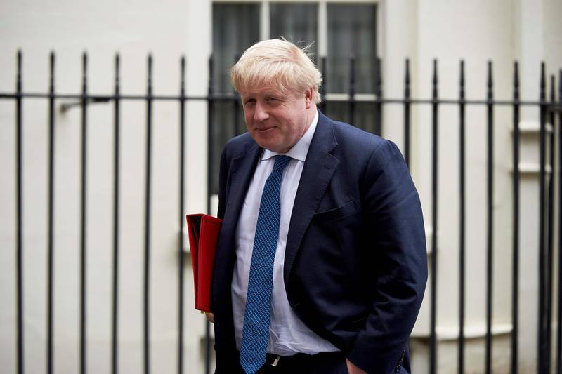 """(FILES) In this file photo taken on April 10, 2018 Britain's Foreign Secretary Boris Johnson leaves from 10 Downing street after attending a National Security Council meeting in London. British Foreign Secretary Boris Johnson has been caught on tape predicting a """"meltdown"""" in Brexit talks and musing admiringly how US President Donald Trump might handle them. In his latest indiscreet remarks likely to embarrass Prime Minister Theresa May, Johnson said the government was reaching a phase in negotiations """"where we are much more combative with Brussels"""". / AFP / NIKLAS HALLE'N"""