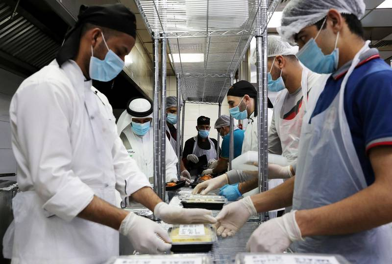 DUBAI, UNITED ARAB EMIRATES , May 01 – 2020 :- Staff of Al Nadeg restaurant in Deira Dubai preparing the food packets to deliver at the labour camp in Al Muhaisnah area in Dubai. This is a part of Mohammed Bin Rashid Al Maktoum 10 Million Meals Global Initiative. Volunteers from Beit Al Khair Society will distribute the food packets in the labour camps. Today they are delivering 1000 food packets from Al Nadeg restaurant. Total 12000 food packets will be deliver in different labour camps in Dubai. (Pawan Singh / The National) For News/Online/Instagram. Story by Anam