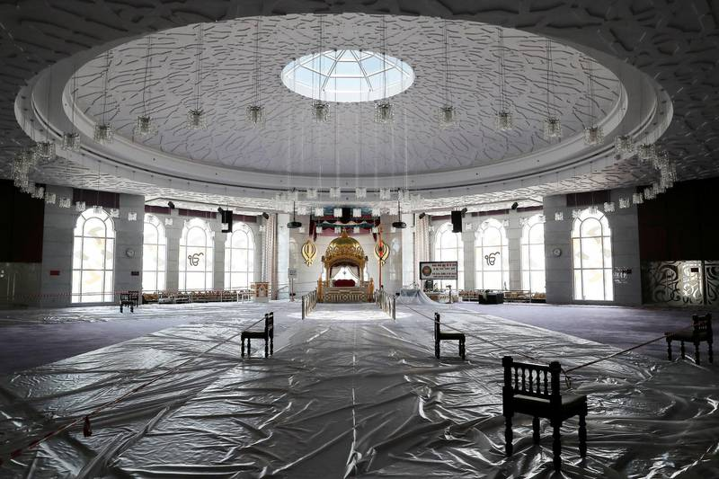 DUBAI, UNITED ARAB EMIRATES , June 30 – 2020 :- Inside view of the main prayer hall and floor covered with plastic sheets as a preventive measure against the spread of the coronavirus at the Gurunanak Darbar in Jebel Ali in Dubai. Places of worship opening up tomorrow in the UAE. (Pawan Singh / The National) For News. Story by Ramola