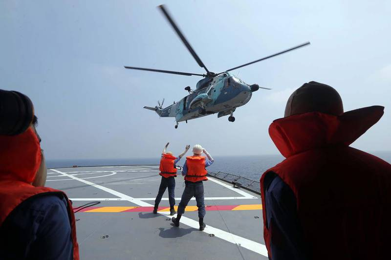 epa08663104 A handout photo made available by Iranian Army official website shows an Iranian army helicopter lands on a warship during the last day of military exercise in Persian Gulf, near strategic strait of Hormuz, southern Iran, 12 September 2020. Iran held a three-days military exercise in Gulf and Oman sea.  EPA/IRANIAN ARMY OFFICE / HANDOUT  HANDOUT EDITORIAL USE ONLY/NO SALES