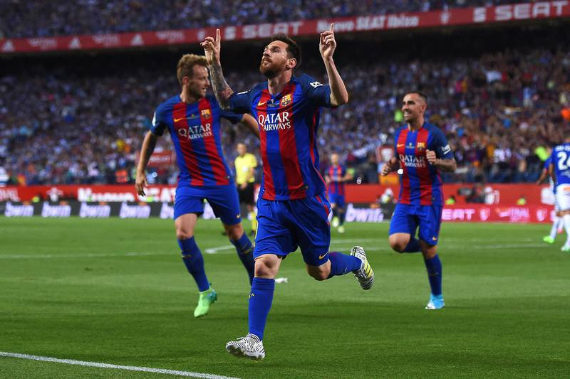 Barcelona's Argentinian forward Lionel Messi (C) celebrates after scoring the opener during the Spanish Copa del Rey (King's Cup) final football match FC Barcelona vs Deportivo Alaves at the Vicente Calderon stadium in Madrid on May 27, 2017. (Photo by Josep LAGO / AFP)