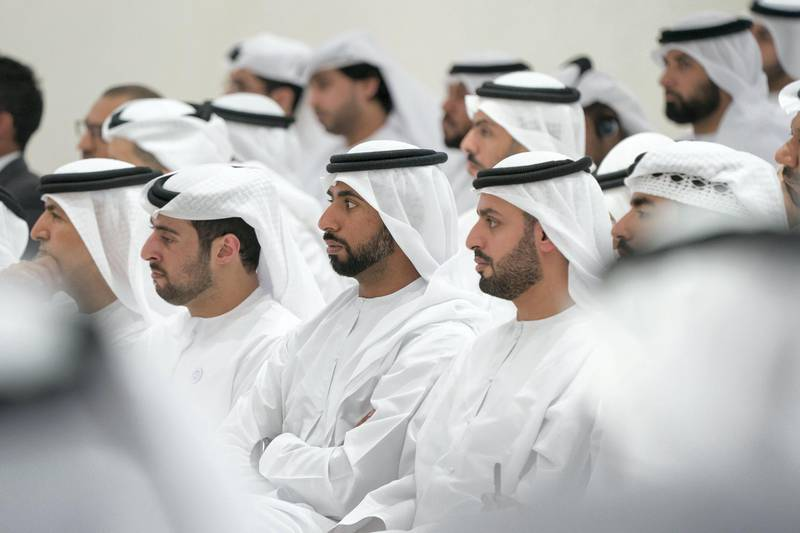 ABU DHABI, UNITED ARAB EMIRATES - May 23, 2018: HH Sheikh Mohamed bin Hamad bin Tahnoon Al Nahyan (R), HH Sheikh Mohamed bin Nahyan bin Mubarak Al Nahyan (2nd R) and HH Sheikh Zayed bin Khalifa bin Sultan Al Nahyan (L), attend a lecture by Angela Duckworth (not shown), titled 'True Grit: The Surprising, and Inspiring Science of Success', at Majlis Mohamed bin Zayed. (Mohamed Al Hammadi / Crown Prince Court - Abu Dhabi ) ---