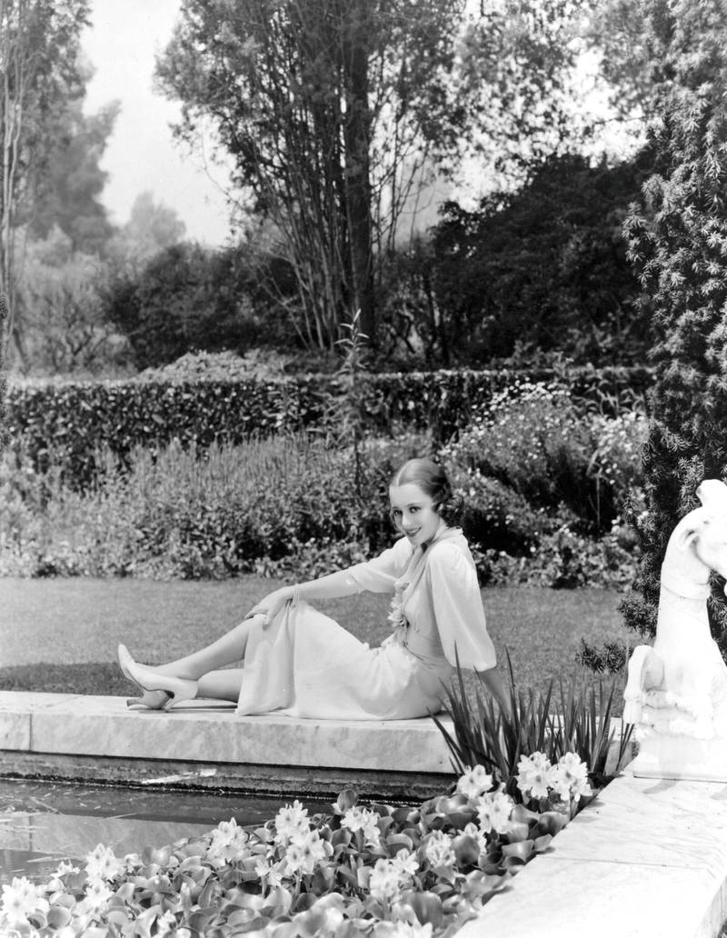 circa 1938:  Hollywood screen star Olivia De Havilland relaxes in the garden of her new home in Hollywood.  (Photo by Hulton Archive/Getty Images)