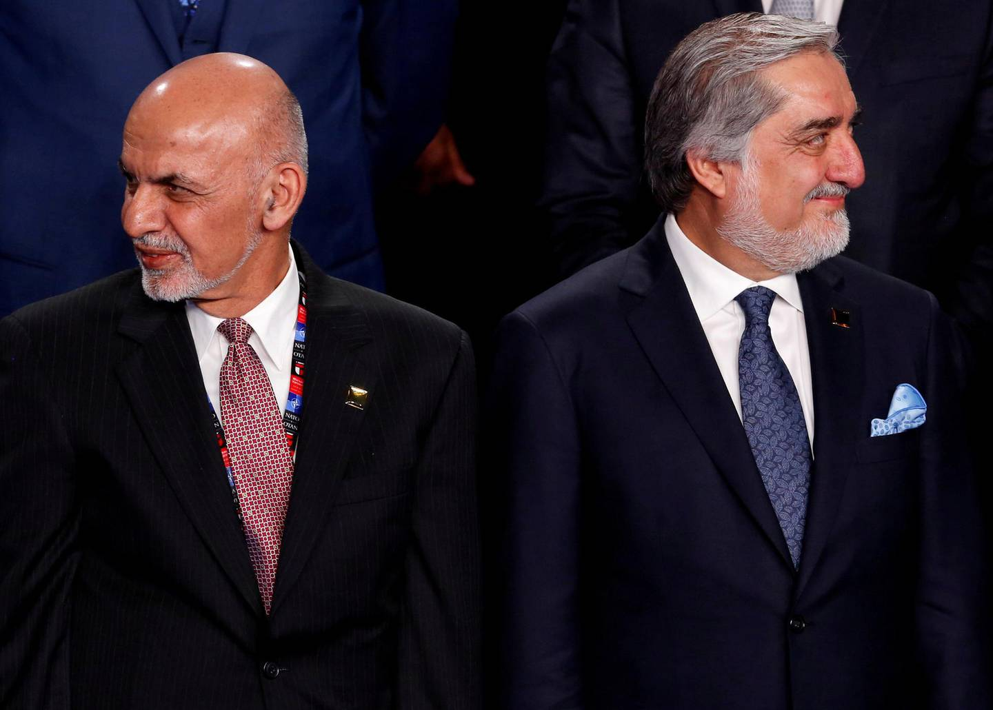 FILE PHOTO: Afghanistan's President Ashraf Ghani (L) and Afghanistan's Chief Executive Abdullah Abdullah (R) participate in a family photo at the NATO Summit in Warsaw, Poland July 8, 2016. REUTERS/Jonathan Ernst/File Photo