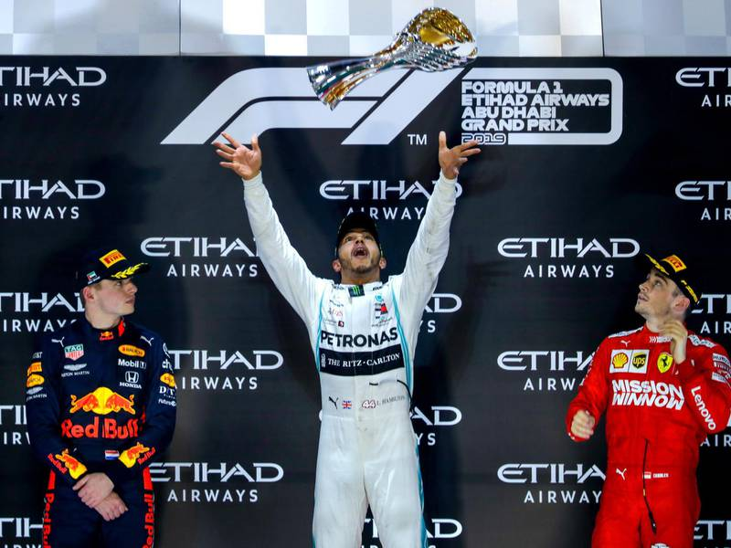Abu Dhabi, United Arab Emirates, December 1, 2019.  Formula 1 Etihad Airways Abu Dhabi Grand Prix.--  Awards Ceremony.(L-R)  Max Verstappen- 2nd place (Red Bull), Lewis Hamilton- 1st (Mercedes) and   Charles Leclerc - 3rd. (Ferrari).Victor Besa / The NationalSection:  SPReporter:  Simon Wilgress-Pipe