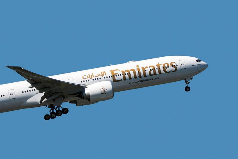 Boeing 777-300ER, long-range wide-body twin-engine jet airliner from Emirates, airline based in Dubai, United Arab Emirates in flight against blue sky. (Photo by: Arterra/UIG via Getty Images)