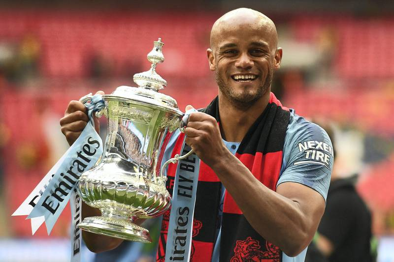 Manchester City's Belgian captain Vincent Kompany holds the winner's trophy after the English FA Cup final football match between Manchester City and Watford at Wembley Stadium in London, on May 18, 2019. - Manchester City beat Watford 6-0 at Wembley to claim the FA Cup. (Photo by Daniel LEAL-OLIVAS / AFP) / NOT FOR MARKETING OR ADVERTISING USE / RESTRICTED TO EDITORIAL USE