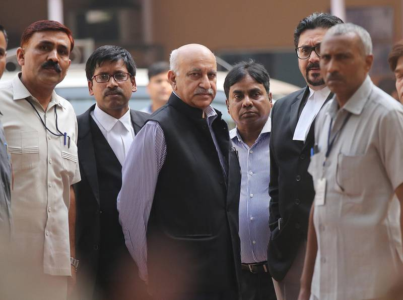 epa07132426 Former Junior Indian Minister for External affairs  MJ Akbar(C) along with the lawyers and Security personnel outside Patiala House court in New Delhi, India, 31 October 2018. According to news reports, MJ Akbar recorded his statements in the court after several women had accused him of sexual misconduct.  EPA/RAJAT GUPTA