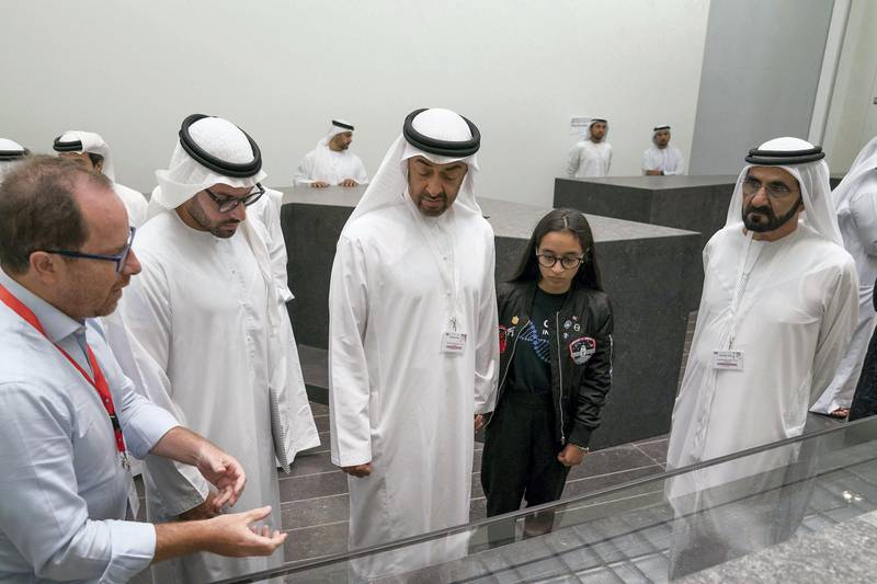 SAADIYAT ISLAND, ABU DHABI, UNITED ARAB EMIRATES - September 11, 2017: (R-L) HH Sheikh Mohamed bin Rashid Al Maktoum, Vice-President, Prime Minister of the UAE, Ruler of Dubai and Minister of Defence, Alya Al Mansouri, HH Sheikh Mohamed bin Zayed Al Nahyan, Crown Prince of Abu Dhabi and Deputy Supreme Commander of the UAE Armed Forces and HE Mohamed Khalifa Al Mubarak, Chairman of Abu Dhabi Tourism and Culture Authority, tour the Louvre Abu Dhabi.  ( Mohamed Al Hammadi / Crown Prince Court - Abu Dhabi ) ---