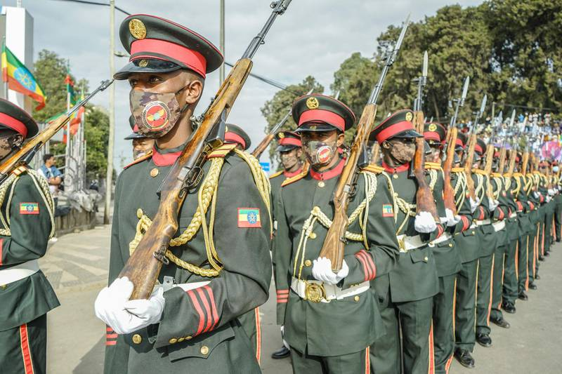 Members of National Defence Force stands on guard during the celebration of the 125th victory of Adwa, at Menelik square in Addis Ababa, Ethiopia, on March 2, 2021. The Battle of Adwa was the climactic battle of the First Italo-Ethiopian War. The Ethiopian forces defeated the Italian invading force on March 1, 1896, near the town of Adwa. The decisive victory thwarted the campaign of the Kingdom of Italy to expand its colonial empire in the Horn of Africa. / AFP / Amanuel Sileshi