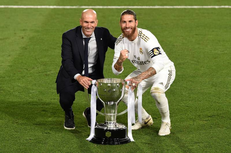 MADRID, SPAIN - JULY 16: Real Madrid head coach Zinedine Zidane and captain Sergio Ramos pose with the La Liga trophy after Madrid secure the La Liga title during the Liga match between Real Madrid CF and Villarreal CF at Estadio Alfredo Di Stefano on July 16, 2020 in Madrid, Spain. (Photo by Denis Doyle/Getty Images)