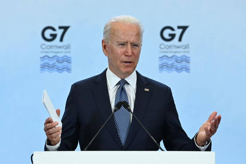 """(FILES) In this file photo US President Joe Biden takes part in a press conference on the final day of the G7 summit at Cornwall Airport Newquay, near Newquay, Cornwall on June 13, 2021. The global infrastructure plan announced by G7 leaders aims to offer developing nations a credible alternative to China's much-criticized Belt and Road Initiative -- but it faces major hurdles on the ground, especially if Beijing's hiccups are any indication.  US President Joe Biden was able to convince the G7 to sign onto the initiative, drawing allies into Washington's strategic rivalry with Beijing, under a plan titled """"Build Back Better World"""" (B3W) that aims to provide hundreds of billions in infrastructure investment to developing nations.  / AFP / Brendan SMIALOWSKI"""