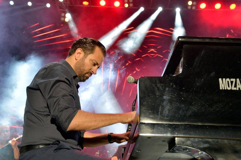 epa06832216 Lebanese musician and Pianist Guy Manoukian performs on stage during a concert at the Summer Misk Festival 2018 in Beit Misk east Beirut, Lebanon, 22 June 2018. The festival runs for two days on 22 and 28 June 2018.  EPA-EFE/WAEL HAMZEH