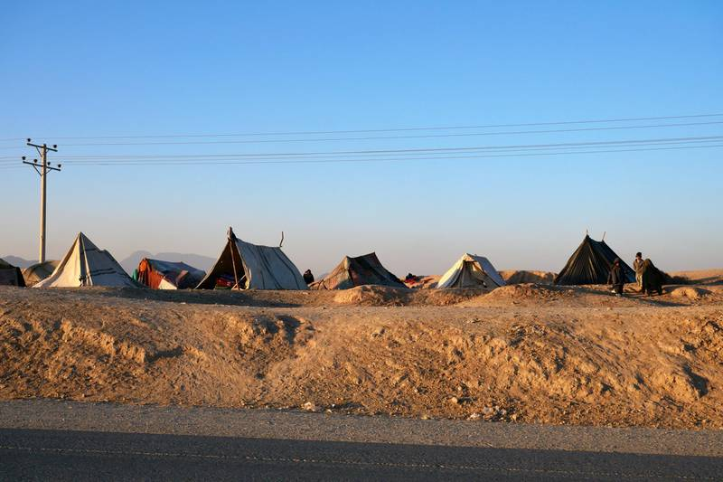 Pictured: Tents now considered home for many Afghan families who have have been forced to flee violence in their villages. This IDP sits on a main road out of Kandahar CIty.  Photo by Charlie Faulkner January 2021