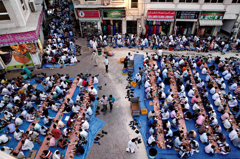 Dubai, July 31, 2013 - Thousands of men break fast together after Maghrib outside Masjid Kuwait Lootah Mosque in Deira, Dubai, July 31, 2013. (Photo by: Sarah Dea/The National, Story by: N/A) *** Local Caption ***  SDEA010813-ramadan_oldnew33.JPGSDEA010813-ramadan_oldnew33.JPG