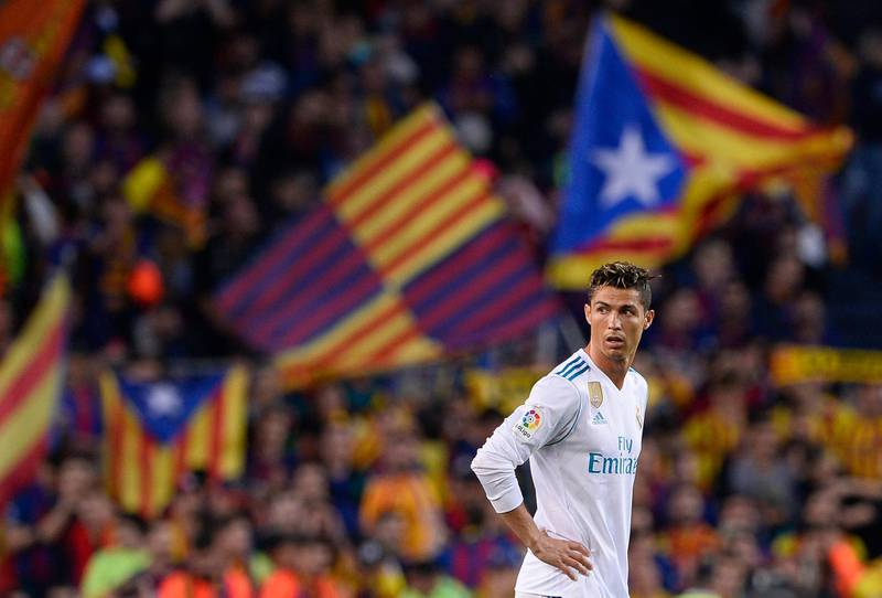 Real Madrid's Portuguese forward Cristiano Ronaldo stands on the field after Barcelona's goal during the Spanish league football match between FC Barcelona and Real Madrid CF at the Camp Nou stadium in Barcelona on May 6, 2018. / AFP PHOTO / Josep LAGO