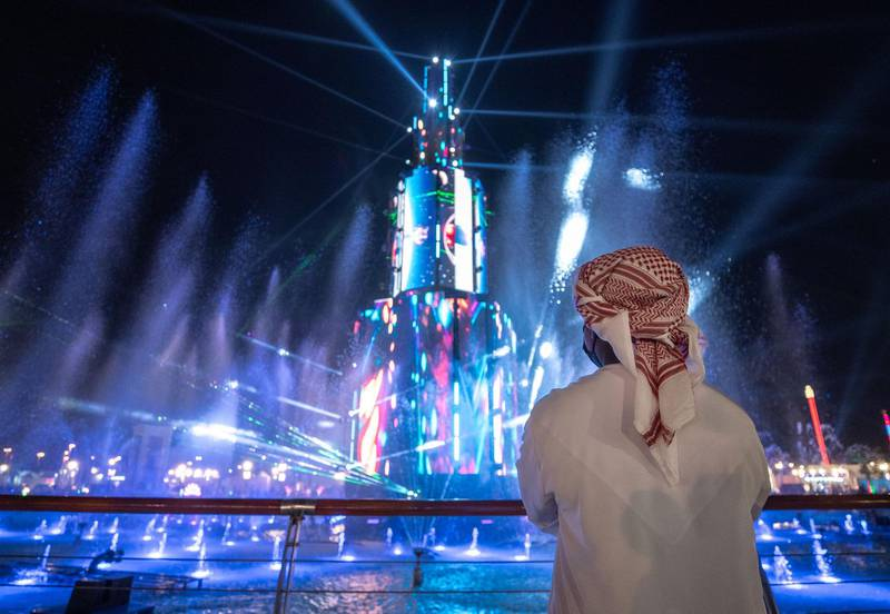 Abu Dhabi, United Arab Emirates, November 23, 2020.   Sheikh Zayed Heritage Festival celebrations at Al Wathba.  Visitors enjoy the lights and sound fountain display.Victor Besa/The NationalReporter:  Samia BadihSection:  NAFor:  Standalone/Stock
