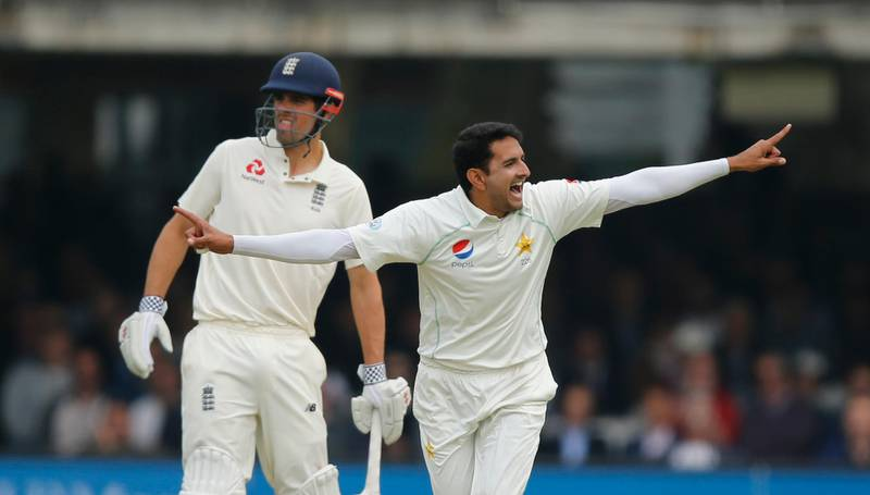 Pakistan's Mohammad Abbas celebrates after taking the wicket of England's Mark Stoneman, as England's Alastair Cook looks on in the background, during the first day of play of the first test cricket match between England and Pakistan at Lord's cricket ground in London, Thursday, May 24, 2018. (AP Photo/Alastair Grant)