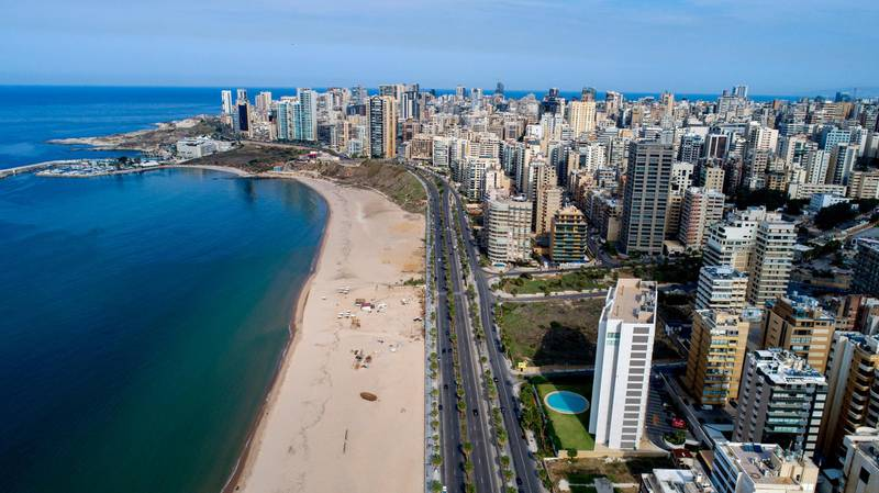 epa08819663 A picture taken with a drone shows empty roads during nationwide COVID-19 coronavirus pandemic lockdown at Ramlet al-Bayda seaside in Beirut, Lebanon, 14 November 2020. Lebanese authorities imposed a curfew on 10 November from 5:00 pm until 5:00 am for a lockdown of 17 days from 14 until 30 November 2020 due to the rise of Covid-19 Coronavirus cases in the country in an effort to curb the spread of coronavirus. Exempted from the closure are Beirut International Airport, the land and sea borders, supermarkets, bakeries, pharmacies, and government institutions that provide services to citizens, doctors, and press.  EPA/WAEL HAMZEH
