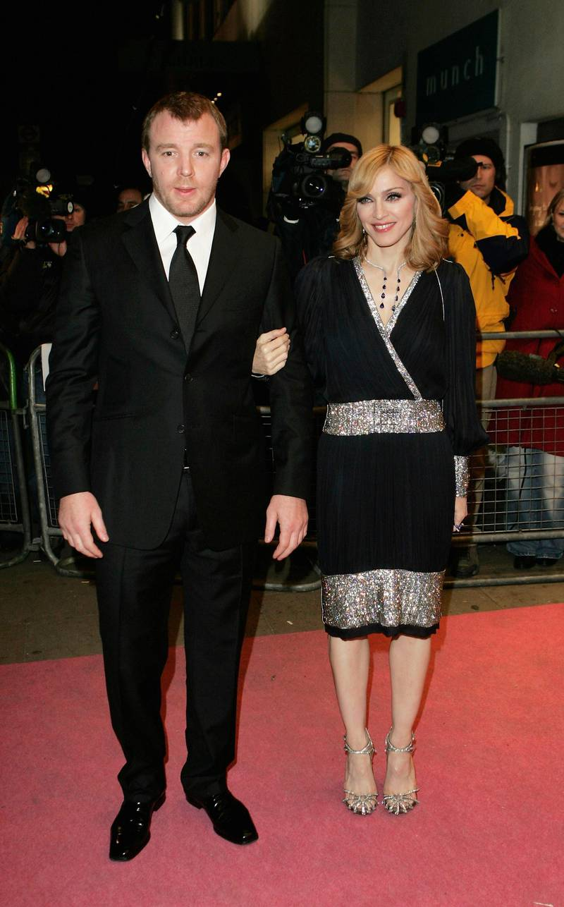 """LONDON - NOVEMBER 29:  Madonna and Guy Ritchie arrive at the UK TV documentary premiere of her new confessional Channel 4 documentary """"I'm Going To Tell You A Secret"""" at the ChelseaCinema on November 29, 2005 in London, England. The programme. Transmitting on December 1, is the first Madonna confessional since 1991's controversial Madonna: Truth Or Dare documentary, profiling the Blonde Ambition tour.  (Photo by MJ Kim/Getty Images)"""