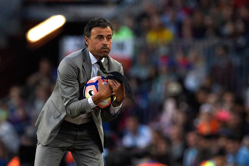 (FILES) In this file photo taken on May 21, 2017 Barcelona's coach Luis Enrique holds a ball during the Spanish league football match FC Barcelona vs SD Eibar at the Camp Nou stadium in Barcelona on May 21, 2017. The Spanish Football Federation named on July 9, 2018 former Barcelona coach Luis Enrique as Spain's new coach. / AFP / LLUIS GENE