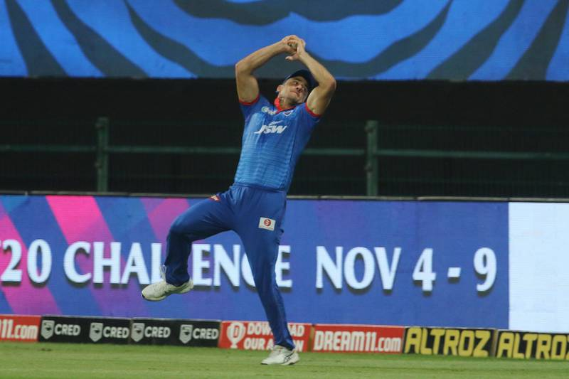 Marcus Stoinis of Delhi Capitals takes a catch of Virat Kohli captain of Royal Challengers Bangalore during match 55 of season 13 of the Dream 11 Indian Premier League (IPL) between the Delhi Capitals and the Royal Challengers Bangalore at the Sheikh Zayed Stadium, Abu Dhabi in the United Arab Emirates on the 2nd November 2020.  Photo by: Vipin Pawar  / Sportzpics for BCCI