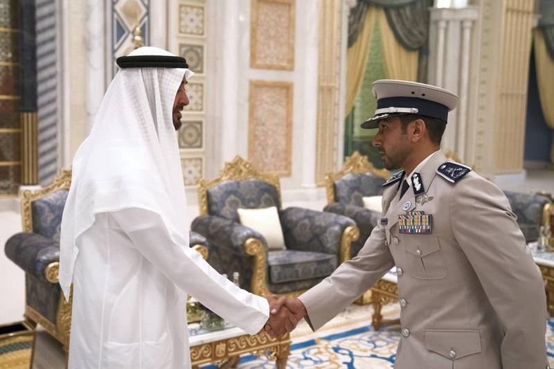 ABU DHABI, UNITED ARAB EMIRATES - May 20, 2018: HH Sheikh Mohamed bin Zayed Al Nahyan Crown Prince of Abu Dhabi Deputy Supreme Commander of the UAE Armed Forces (L), receives HH Sheikh Mohamed bin Tahnoon Al Nahyan (R), during an iftar reception at the Presidential Palace.   ( Hamad Al Kaabi / Crown Prince Court - Abu Dhabi ) ---