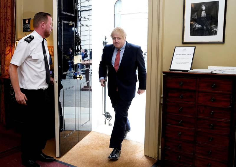 """A handout image released by 10 Downing Street, shows Britain's Prime Minister Boris Johnson returning to 10 Downing Street in central London on April 27, 2020 after making a statement to the media on his first day back at work following more than three weeks off after being hospitalised with the COVID-19 illness. - Prime Minister Boris Johnson on Monday made his first public appearance since being hospitalised with coronavirus three weeks ago, saying Britain was beginning to """"turn the tide"""" on the outbreak but rejecting growing calls to ease a nationwide lockdown. (Photo by Andrew PARSONS / 10 Downing Street / AFP) / RESTRICTED TO EDITORIAL USE - MANDATORY CREDIT """"AFP PHOTO / 10 DOWNING STREET / ANDREW PARSONS """" - NO MARKETING - NO ADVERTISING CAMPAIGNS - DISTRIBUTED AS A SERVICE TO CLIENTS"""