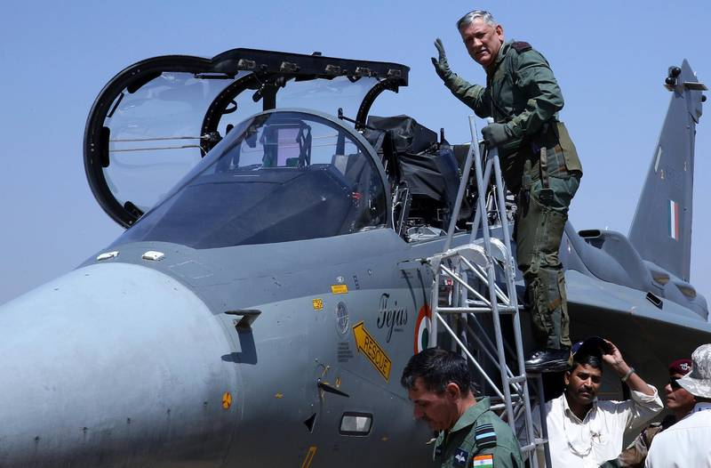 epa07385447 Chief of The Indian Army Bipin Rawat gestures before he sits inside the cockpit of Indian Air Force (IAF) Tejas fighter jet during the second day of the 12th edition of the Aero India 2019 at the Yelahanka Air Force Station in Bangalore, India, 21 February 2019.  Over 350 defense and aerospace firms from 30 countries are taking part in the event running from 20 to 24 February.  EPA/JAGADEESH NV