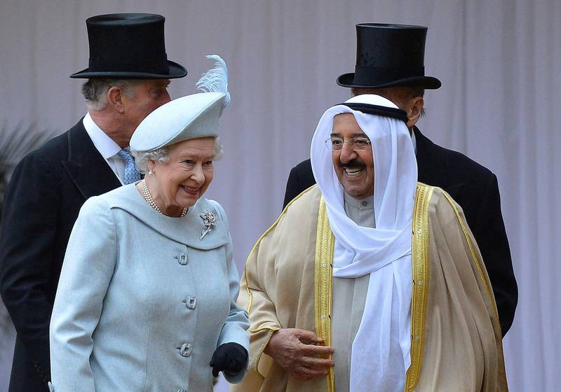 WINDSOR, ENGLAND - NOVEMBER 27:  The Amir Sheikh Sabah Al-Ahmad Al-Jaber Al-Sabah of Kuwait chats with Queen Elizabeth II as he arrives at Windsor Castle during a three-day state visit on November 27, 2012 in Windsor, England. In the afternoon a military parade will be inspected at Royal Military Academy Sandhurst then a banquet is to be held at Windsor Castle in the Amir's honour this evening.  (Photo by Toby Melville - WPA Pool/Getty Images)