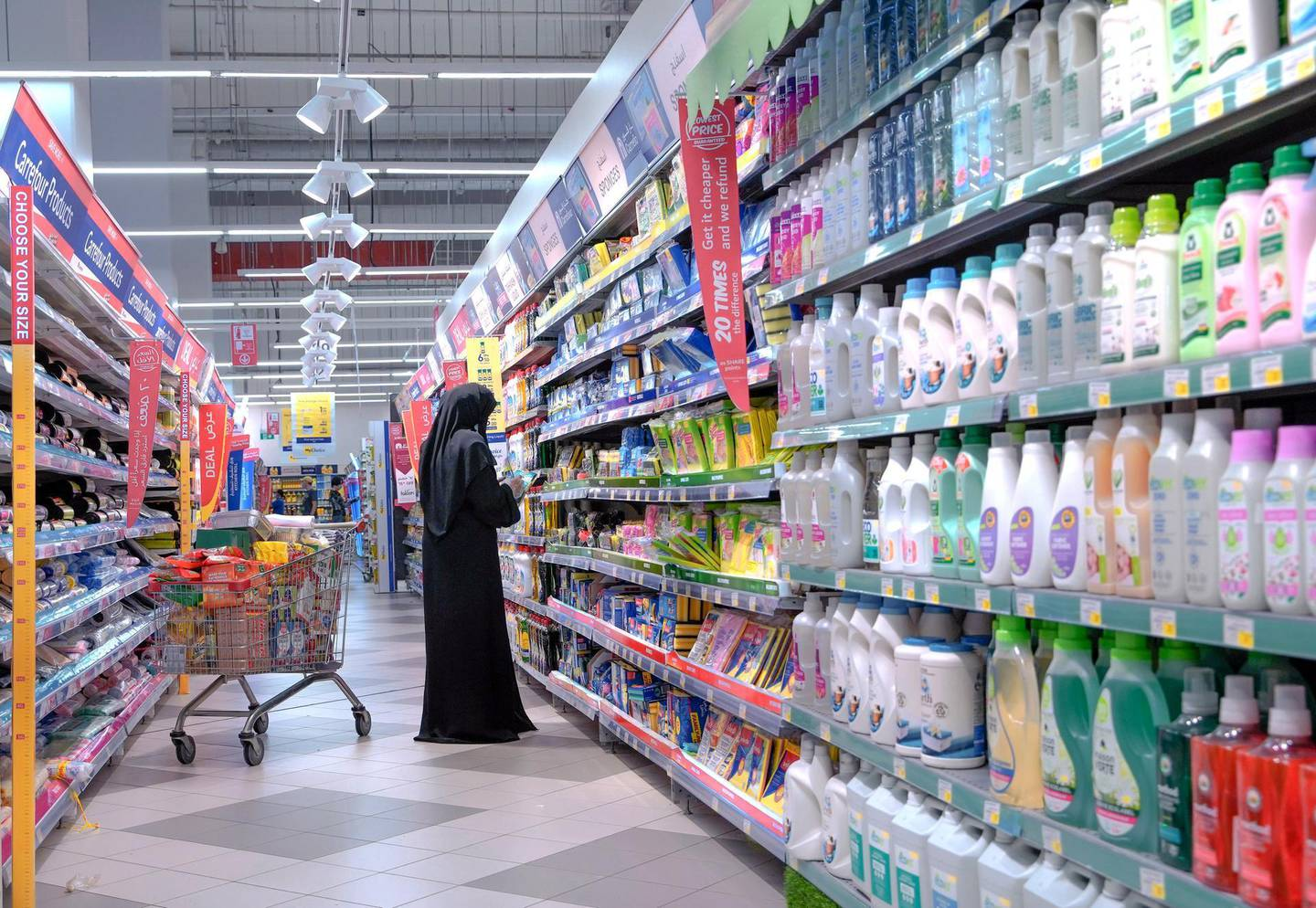 Abu Dhabi, United Arab Emirates, April 21, 2020.   Early Ramadan shoppers at Carrefour Yas Mall.  A lady searches for some disinfectants for the Coronavirus Pandemic.Victor Besa / The NationalSection:  NAFor:  Stock images